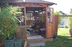 "My Tea House. It is made of Redwood and was formerly an enclosure for a hot tub.  We bought it used and moved it, in sections, to our yard to use as a gathering place out of the sun.  It measures 12 x 10'.  The tea house and inside furnishings were all purchased ""used"".  I adore decorating on a budget."