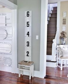 Ten fun ideas on how to decorate with marquee letters and numbers.....including this vintage growth chart!  thistlewoodfarms.com