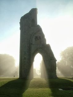 Glastonbury, England - the resting place of King Arthur. I love the idea of King Arthur and the round table to I'd love to be able to visit here.