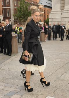 Sarah Jessica Parker went all out in a voluminous ivory frock and black trench.