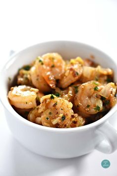 Brown Butter Garlic Shrimp Recipe - makes a fast, yet fabulous quick-fix favorite dish. So versatile, this garlic shrimp can be used to top pasta or a bowl of cheesy grits! //addapinch.com
