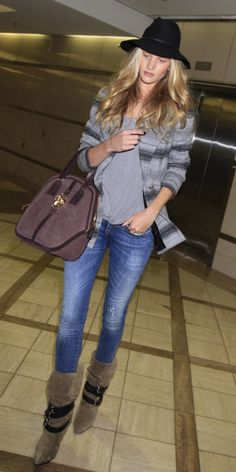 Rosie Huntington-Whiteley looks amazing as she goes through TSA security at LAX. The leggy Victoria's Secret model was seen at LAX wearing tight jeans, boots and a floppy hat, but she took off her hat, sweater and boots to go through security. #airport #celebrity #style #fashion #actress #model #looks #travel