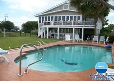 Murrays Inlet Shack is a four-bedroom, two-and-a-half bath home located 1.5 miles south of Garden City Pier, with easy beach access located across the street.