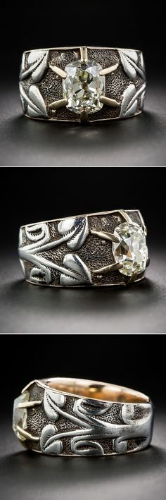 2.50 Carat Antique Cushion-Cut Diamond Art Nouveau Ring. We've never seen anything quite like this exotic and strikingly beautiful diamond ring, artfully hand crafted in silver over gold and presenting a gorgeous and glistening antique cushion-cut diamond weighing approximately 2.50 carats. The radiant rock is held by six yellow gold prongs against a darkly textured, oxidized silver backdrop overlaid with sinuous vines sprouting heart shape flowers rendered in bright, contrasting silver