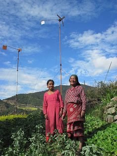 Kamala Phakarin and her daughter-in-law from Phakel village in Nepal stand proudly next to their wind turbine, which provides them with enough energy to light their home and power a radio and mobile charger, enabling them to stay connected to relatives and reducing exposure to indoor fumes. from the guardian - photo by renewableworld http://www.guardian.co.uk/global-development/gallery/2012/mar/23/gender-international-womens-day?CMP=EMCGBLEML1625#/?picture=387549715=11