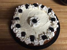 White chocolate vanilla bean cheesecake with blackberry garnish