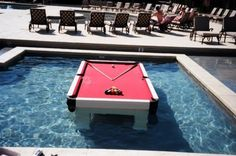 "Play Pool In The Pool Yup that's right. This waterproof pool table lets you enjoy everyones favourite bar game right in the middle of your swimming pool! The table can be left outdoors through almost any weather conditions and still be in great shape for your weekend barbecue. At a price of $6500.00 I'm unfortunately going to have to add it to my ""when I win the lottery"" list, and also add a swimming pool to the list too."