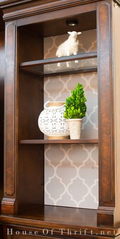 Put peel and stick wallpaper in the back of a dark entertainment center | Moroccan Grey peel and stick wallpaper | House Of Thrift