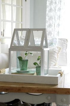 DIY Picture Frame Greenhouse Terrarium // I made mine with lightweight frames, hot glue, and white duct tape.  To make a picture frame greenhouse like mine, you will need to start with 8 lightweight picture frames: Two 8 X 10′s, Two 5 X 7′s, and four 4 X 6′s.