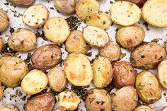 Oven roasted new potatoes with olive oil, garlic, rosemary, and halved new potatoes.