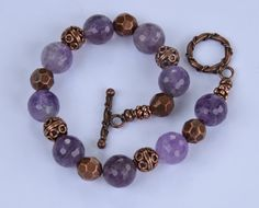 Antique Copper and Amethyst Gemstone Beaded Bracelet with Antique Copper Toggle Clasp.   10mm Amethyst Gemstones.  8.25 inch bracelet.