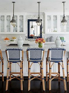 Blue and white striped counter stools are such a fun, easy way to update your kitchen!
