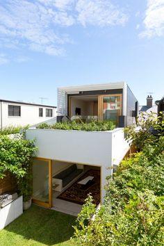 toit végétal, un toit planté de maison cubique