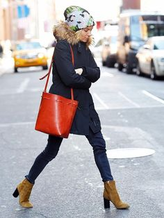 Sienna Miller wearing: Woolrich Arctic Parka; Isabel Marant Tan Suede Garbo Bootsy Boots; Mansur Gavriel Leather Bucket Bag