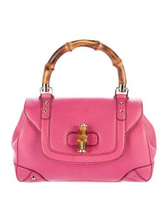 Pink pebbled calfskin leather Gucci bag with gold-tone hardware, single bamboo top handle, stud embellishments throughout, brown woven lining, dual interior compartments, single zip pocket at interior wall and bamboo turn-lock closure at front flap. Includes dust bag. Shop authentic designer handbags by Gucci at The RealReal.