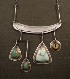 """""""Swamp Thing"""" necklace by Emily Hickman.  Sterling silver, 22k gold, green turquoise, variscite, and glass taxidermy eye"""