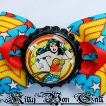 """This awesome Wonder Woman inspired hair bow measures approx 2.75"""""""" by 2.5"""". It secures in place with an alligator clip. All ends have been sealed to prevent fraying. This hair bow has been professionally stiffened to make sure it maintains it`s lovely shape!"""