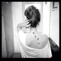 I love this neck bird tattoo