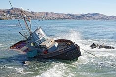 """Abandoned Fishing Boat: """"Catch of the Day"""" ©Darin Volpe. The Point Estero washed up on the rocks north of Cayucos, California. Buy a print at http://shop.dvtwist.com/featured/catch-of-the-day-abandoned-fishing-boat-in-cayucos-california-darin-volpe.html"""