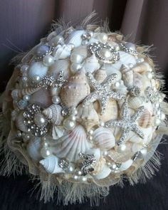 Beautiful Bouquet from shells burlap and vintage brooches and rhinestone starfish. so sparkly