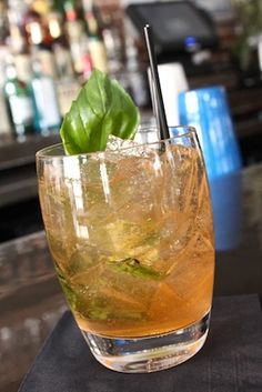 Spicy Basil Cocktail - We adapted it with vodka and ginger beer so we didn't have to buy special liquors, but the basil and sriracha are what make this drink unique and awesome - Ali