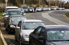 Cars wait in line for fuel at a gas station in Staten Island even though it is currently out due to shortages following Hurricane Sandy, in New York November...  news.yahoo.com