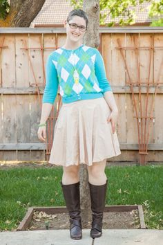 Blue, green, yellow, and white argyle cardigan, khaki skirt, brown boots, DIY dip-dyed lace necklace.