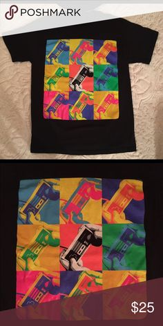 "Nintendo NES controller pop art Warhol tee shirt Brand: unbranded - no labels  Size: no labels but looks like a medium see measurements  Measurements: underarm to underarm: 18"", shoulder to hem : 25.5""  Condition: VGUC   Cool old school super Nintendo controller pop art Andy Warhol style shirt ! Tops Tees - Short Sleeve"