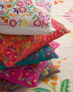 colorful embroidered pillows
