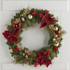 A textbook example of the ideal Christmas wreath, this handcrafted Pier 1 exclusive features the deepest reds, greens and golds you'll see all season, thanks to lush faux winter foliage and lustrous ornaments. Perfect for mantels, doors and centerpieces.