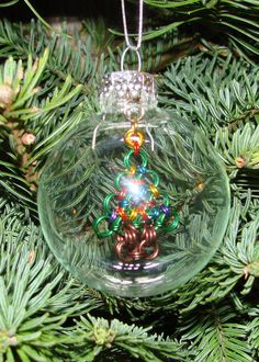 """2-5/8"""" Clear Glass Ornament with a Chainmaille tree inside. $35.00, via Etsy."""