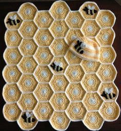 http://www.ravelry.com/patterns/library/sweet-as-honey-baby-blanket-and-hat-set-with-bee-applique