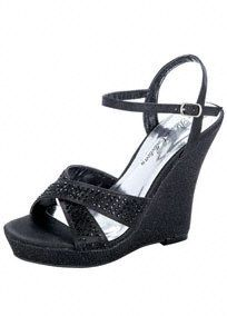 "Dress up or dress down, this wedge will be the perfect accessory for the summer!  Glitter mesh wedge sandal features sparkling criss-cross strap detail.  5"" heel. 1"" platform.  Available in Black.  Fully lined. Imported."
