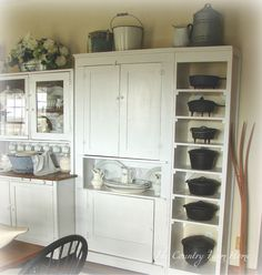The Country Farm Home: The Farmhouse Keeping Room Is Revealed - Love the open shelves displaying the cast iron. The Farm, Country Farm, Country Decor, Primitive Country, Casas Magnolia, Armoire, Iron Storage, Hoosier Cabinet, Iron Shelf