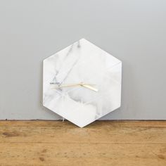 Karlsson Hexagon Clock: Marble clock with gold hands. A beautiful statement piece, would look lovely in any room.