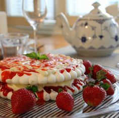 Cake with whipped cream & strawberries