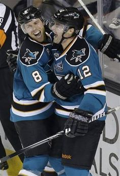 San Jose Sharks center Patrick Marleau (12), right, celebrates with teammate Joe Pavelski (8) after Marleau scored the go-ahead goal against the Phoenix Coyotes during the third period of an NHL hockey game in San Jose, Calif., Thursday, Jan. 24, 2013. San Jose won 5-3