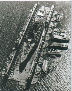 W.W. II, US New Mexico-class battleship in floating dry dock.