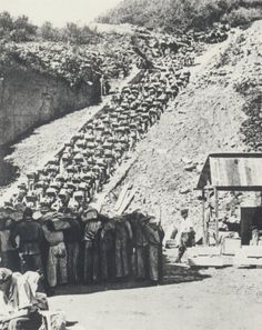 """Infamous """"Stairs of Death"""" in Mauthausen quarryPrisoners were forced to climb the 186 steps of the Wiener Graben with large blocks of granite on their backs. Often the blocks would fall, crushing limbs and bodies of those following, sometimes killing. The SS guards invented competitions betting on which prisoner would make it to the top first. Those surviving the ordeal would then be forced to jump from the edge of the quarry to their death below."""