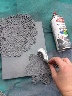 PAPER doileis. Tape to hold the doilies in place and then sprayed them.  The paint does get under the doiley a little and makes it look a little fuzzy but I think that it gives it character and dimension.  SO CUTE, EASY and CHEAP!