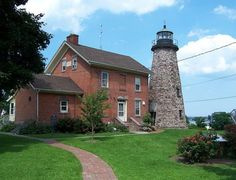Charlotte Genesee Lighthouse - Rochester, NY     This lighthouse, with its 40-foot tower, was built in 1822. In 1881, the light was removed from service and the lantern transferred to a pier lighthouse. For 100 years the tower was abandoned until 1982 when it was restored and began operation as a museum.   (Public - M,G,P)   www.geneseelighthouse.org