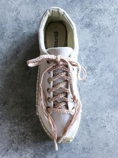 It may come as no surprise to you that if I could add tassels and pom poms to everythingin sight, I would. Wouldn't they make life that much happier and more colorful? Sadly,even I know that too much can be . . . just too much. However,when I discover themost perfectpair of espadrille