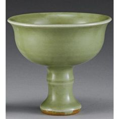 A 'longquan' celadon-glazed stemcup. late Yuan / early Ming dynasty.  The deeply rounded sides flaring at the rim, supported on a ribbed stem, applied overall with a rich celadon glaze - height 3 1/2 in., 8.3 cm.