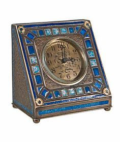 "Tiffany Studios Art Deco Pattern Clock    Tiffany Furnaces gilt bronze & enamelled ""Art Deco"" pattern desk clock decorated with blue enamel design. The clock is signed, ""Louis C. Tiffany Furnaces Inc. 360"" further signed with the Furnaces monogram. circa 1910"