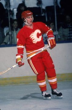 American professional hockey player Joe Mullen forward for the Calgary Flames on the ice during a game 1980s.