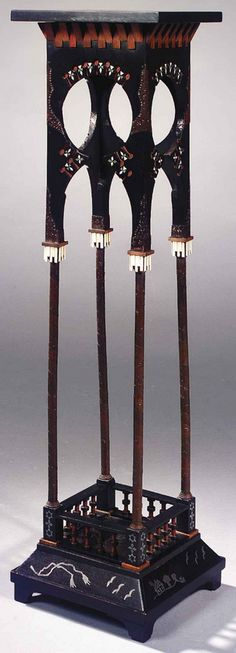 CARLO BUGATTI Sellette, c. 1900, Ebonised wood and fruitwood, the square top raised on four slender columns on a square base, the whole decorated with geometrical and abstract motifs of pewter inlay, chased copper mounts and ivory applications, height 98cm, top 27x27cm, restored     SOLD $7,054 Sotheby's Amsterdam, Nov. 11, 2003