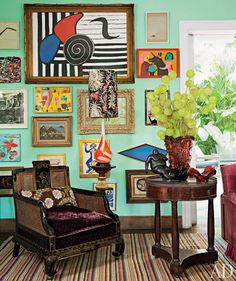 Ethnic Cottage Decor: Maximalism or...MORE IS MORE Decor! simply wonderful... that chair...ed
