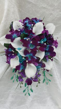 Galaxy orchid bridal bouquet, purple blue island orchid bouquet, white real touch calla lilies, turquoise Galaxy orchid bridal bouquet purple blue island by DressMyWedding Orchid Bridal Bouquets, Bridal Flowers, Flower Bouquet Wedding, Bride Bouquets, Purple Orchid Bouquet, Rose Bouquet, Purple Orchid Wedding, Hand Bouquet, Bridesmaid Bouquets