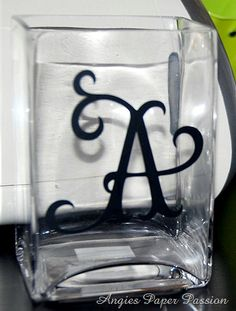Monogram glass with vinyl letters using cricut craft machine. Perfect for a hostess gift.