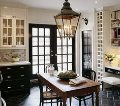 French doors, doors painted black, wine rack.